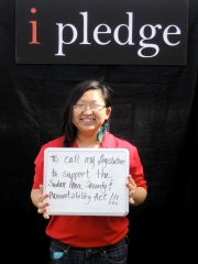 At the Ambassador's advocacy table at the Camp Darfur event, Ambassador Song makes her pledge to help the people of Sudan.