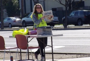A Fresno State student sells Kids Day papers to raise money for Children's Hospital Central California.