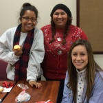 SERVE Members Oshea, Bianca, and Mikayla celebrate a successful fall semester at the semester end celebration.
