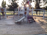 A before photo of the playground in the early morning light.