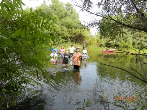 Our brave team wades across the river to begin the cleanup. (All photos courtesy of River Tree Fresno.)