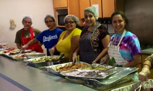 Volunteers are ready to serve delicious recovered food! Photo credit: Fresno State FRN Facebook page