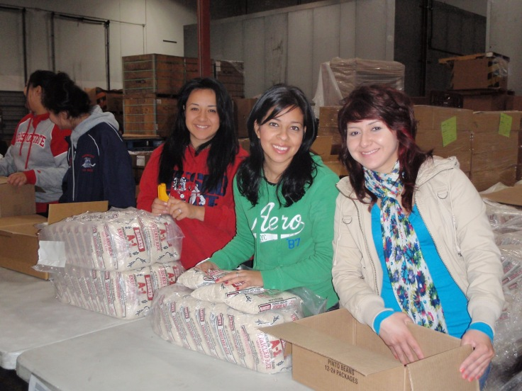 Fresno State students help out at the Community Food Bank, preparing Holiday baskets.