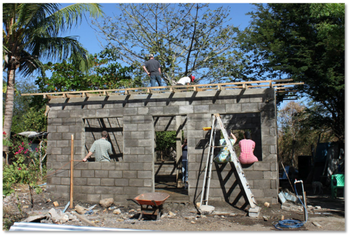 Volunteers build a home for a family in need. Photo Courtesy of:  Fullerton Center Global Builder (http://www.fullercenter.org/global-builders/nicaragua)