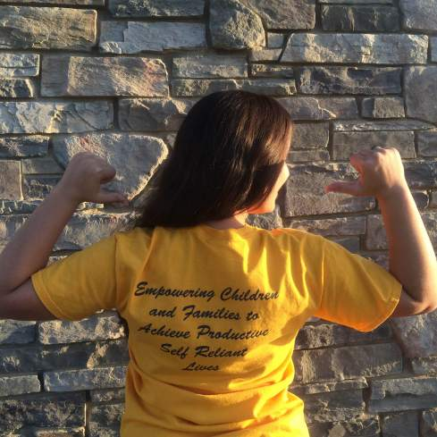 """I'd arrive clad in my painfully bright yellow t-shirt, which boldly stated, """"Reading and Beyond,"""" and on the back, """"Empowering children and families to achieve productive, self-reliant lives."""""""