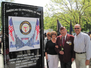Rudy with his daughter Debbi and son Gary at the Ex POW Monument. Photo Credit Gary Giannoni